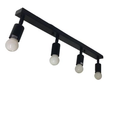 Material: Metal y Plástico Tensión: 220v Frecuencia: 50Hz Casquillo: E27 x 4 NO INCLUIDAS Color: Negro Alto: 100 mm Base: 600 mm